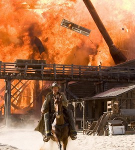 Jonah Hex (Brolin) rides away from exploding town